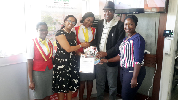 The AWA Commercial manager Katherine Tosan Woode  receives Weizo document from Mr Ikechi uko in Accra